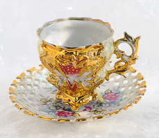 cup and saucer dipped in gold - baroque cup with strawberry pattern on lacticed saucer with gilding